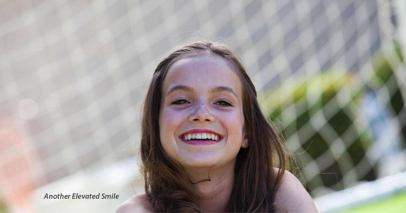 young girl smiling happily